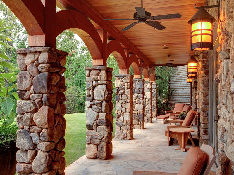 The arches lend elegance to a covered porch.